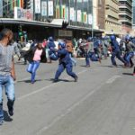 Protesters clash with riot police in Zimbabwe's capital