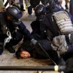 Hong Kong protesters defy ban and battle police