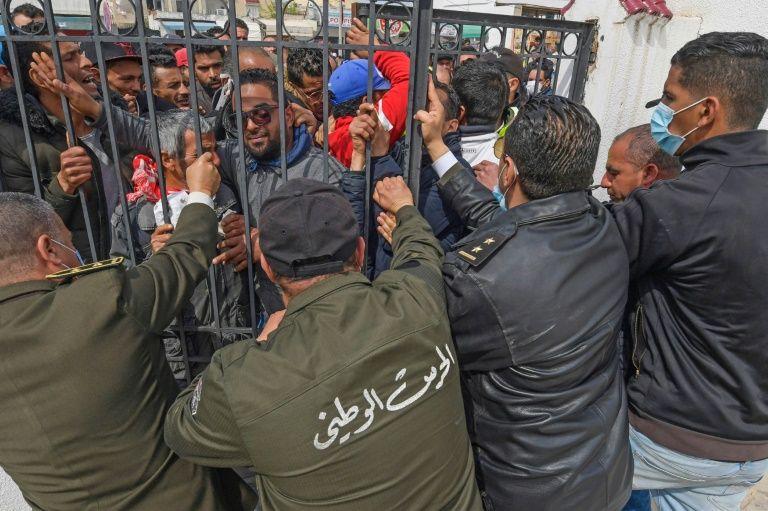 Hundreds of Tunisians protest over virus lockdown