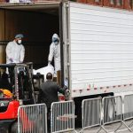 US Coronavirus Death Toll Rises As Bodies Are Being Loaded At The Back of Trucks (Photos)