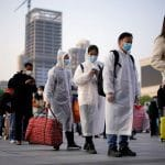 Wuhan exodus sparks hope despite mounting virus death toll