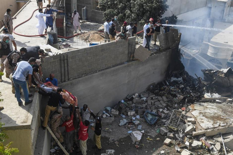In Pakistan - Passenger plane with 100 on board crashes on homes