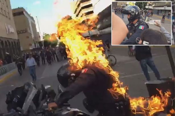 Protesters Set Police Man On Fire Over Man 'Beaten To Death For Having No Mask'