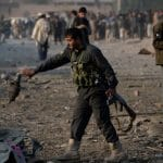 Taliban raids on Afghan security posts kill 18