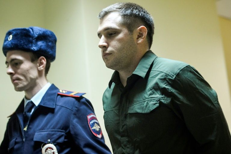 Russia jails US ex-marine for 9 years over police assault