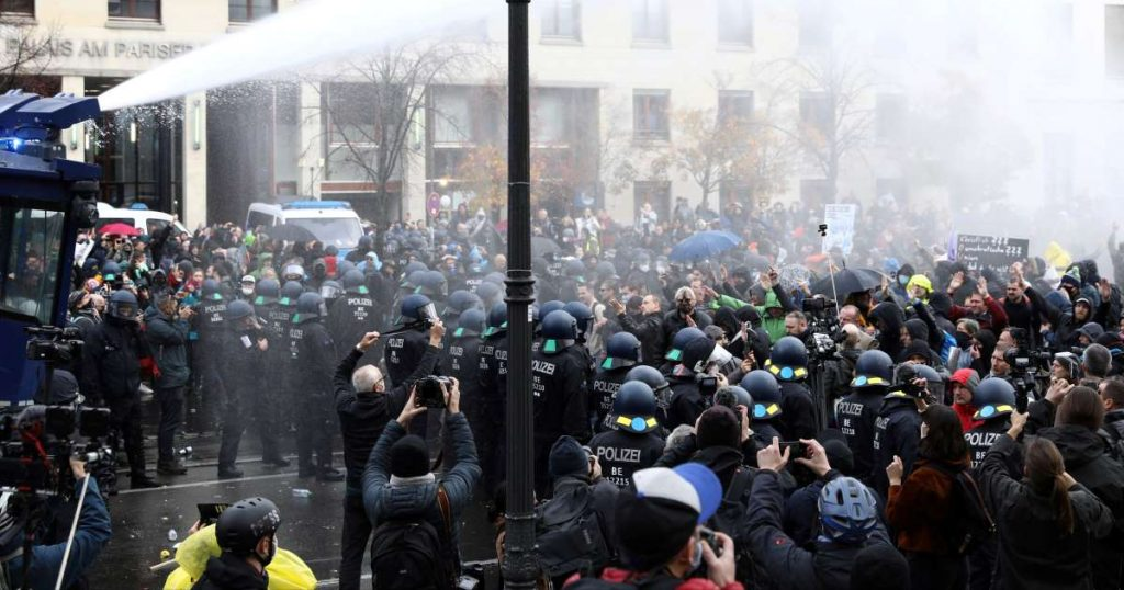 Police fire water cannon at anti-lockdown protesters in Berlin Germany